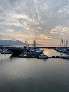 Dawn with view across the marina boats towards the Mourne mountains